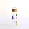 Glass carafe with bamboo lid printing on bottle